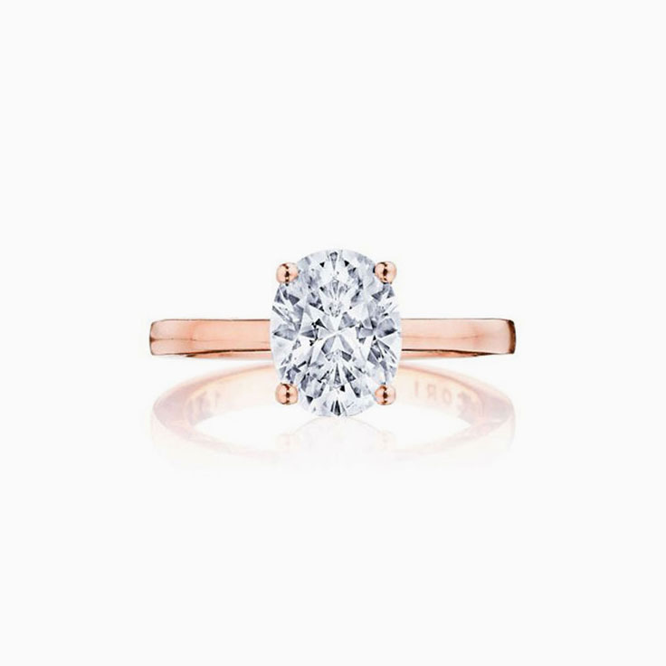 Oval Cut diamond engagement ring on a plain band