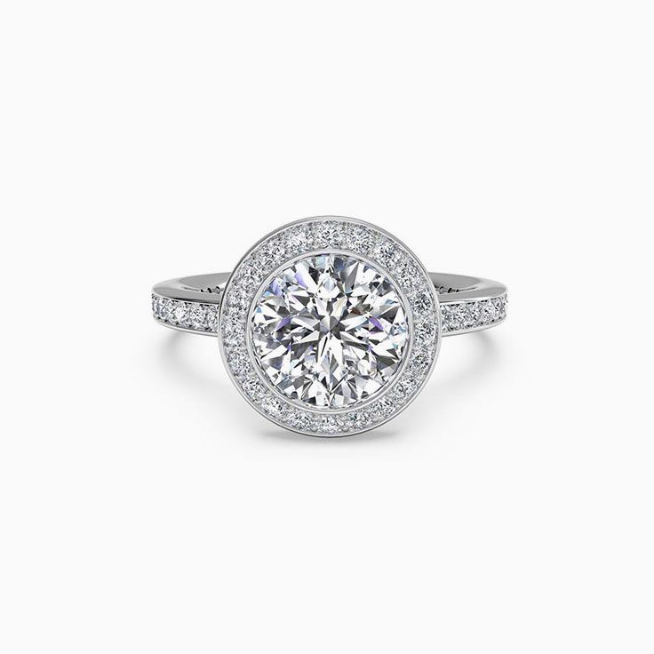 Round Brilliant cut diamond engagement ring with pave halo
