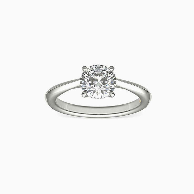 Round brilliant cut diamond on knife edge band enagement ring