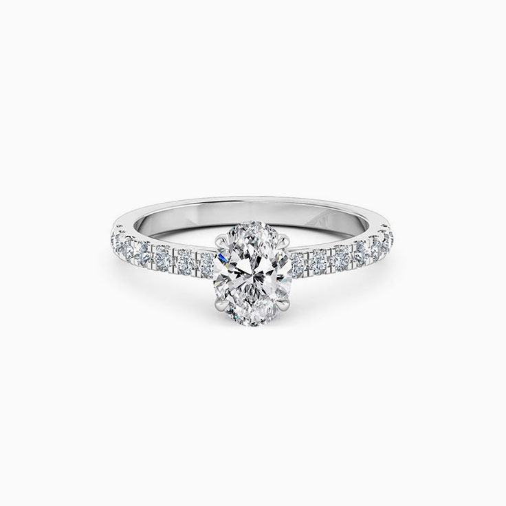 Oval cut diamond engagement ring set on a diamond band