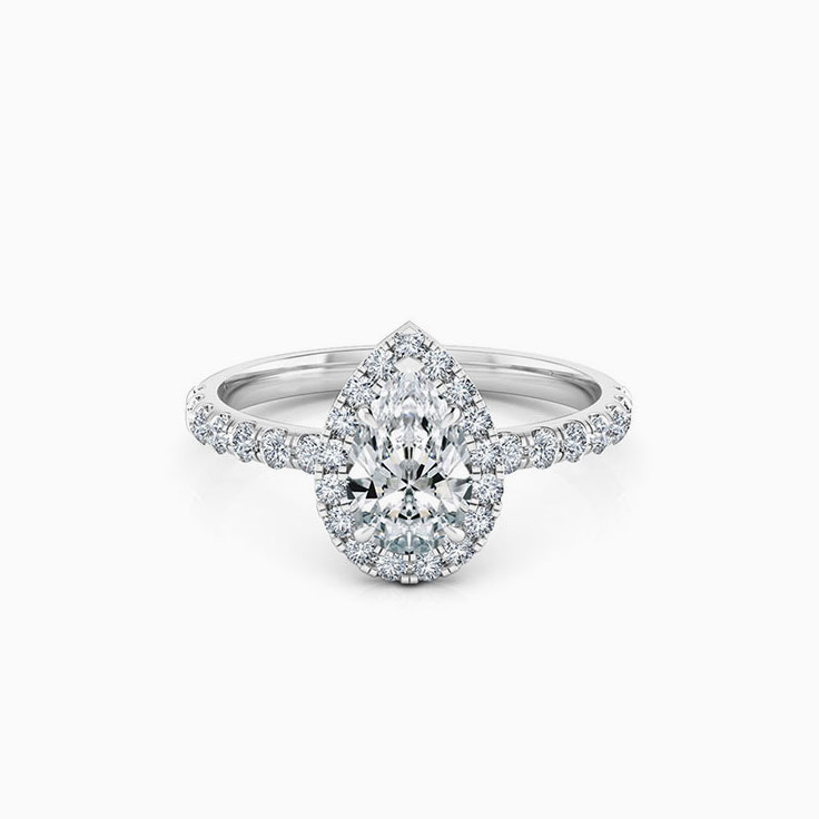 Pear cut diamond engagement ring with halo