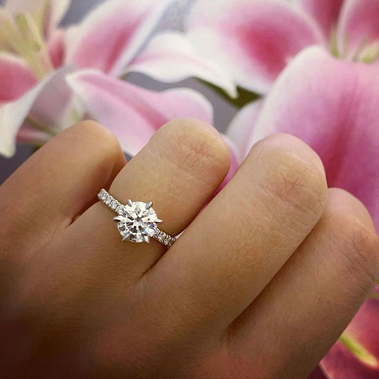 Round brilliant cut diamond in a six claw setting an diamond band