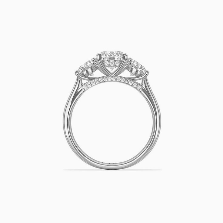 Round brilliant cut diamonds in a trilogy setting engagemnt ring